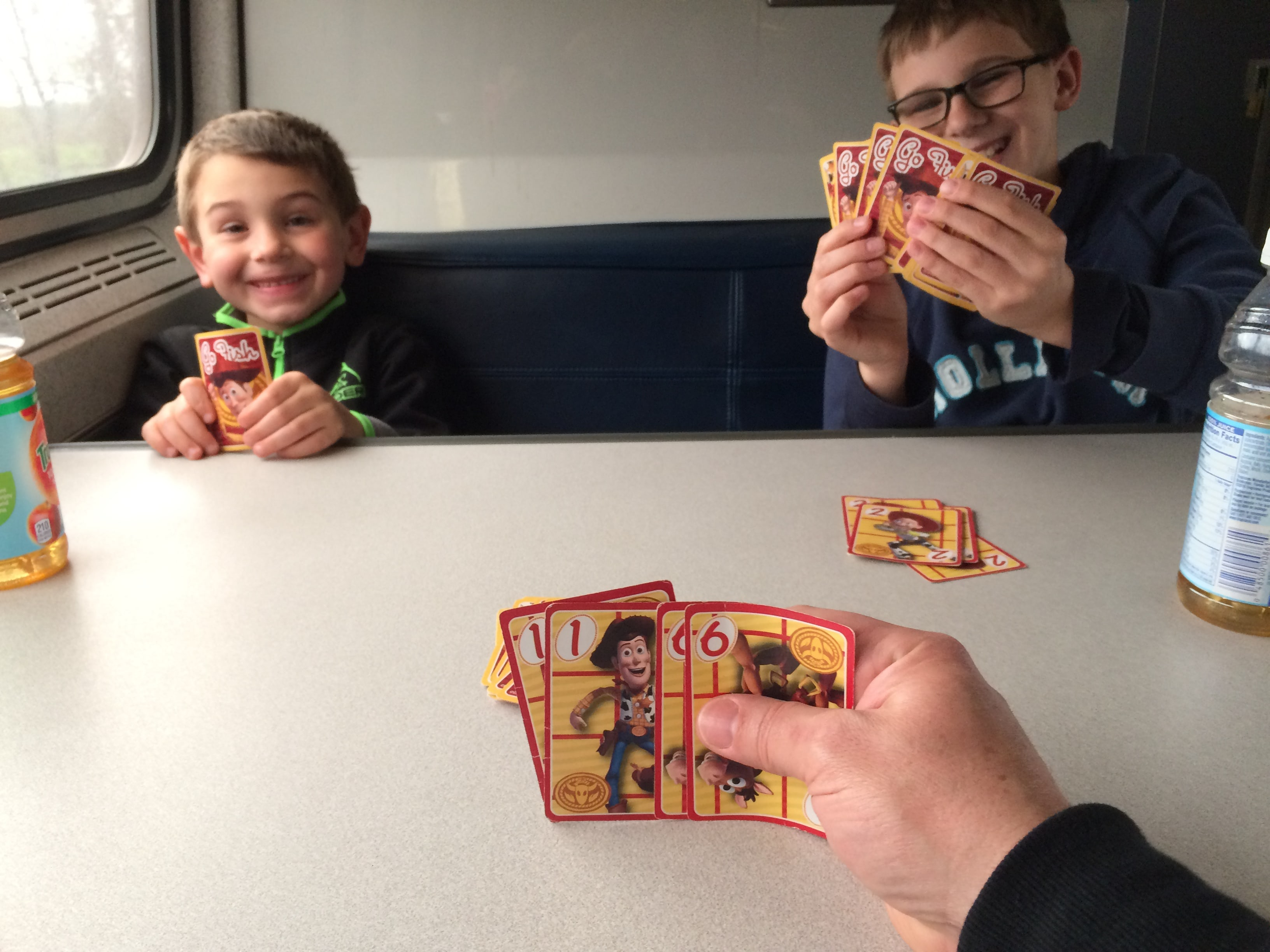 Playing card games in dining car of Amtrak train