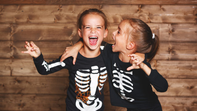 Girls laughing in Halloween costumes